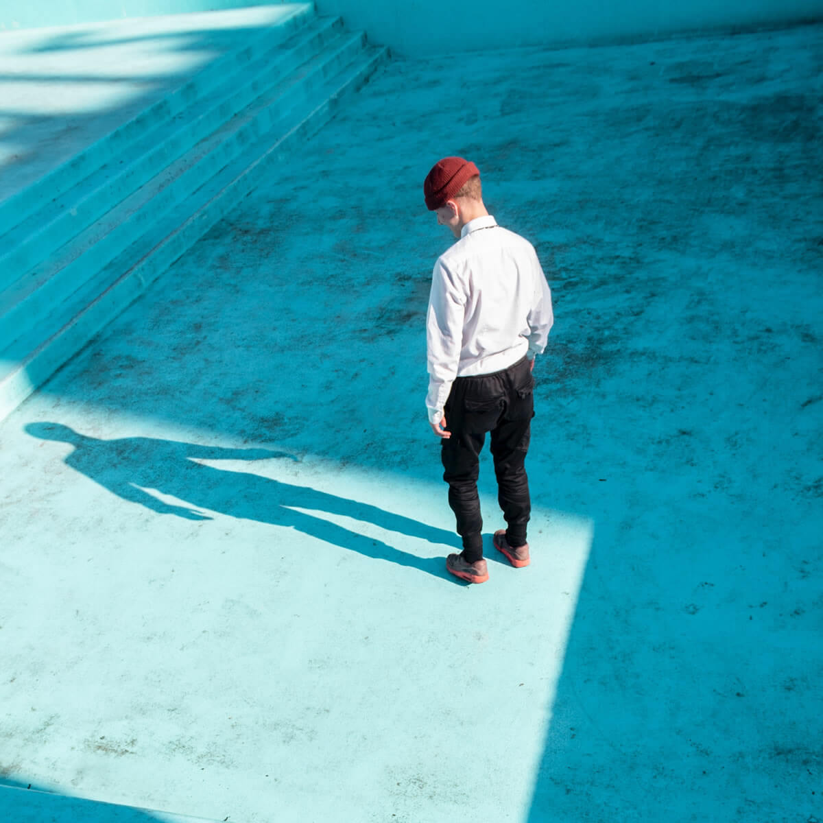 man standing on the center of empty pool